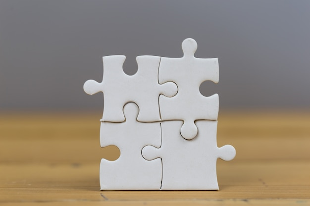 Businessmen put the last puzzle piece, business service concept to success.