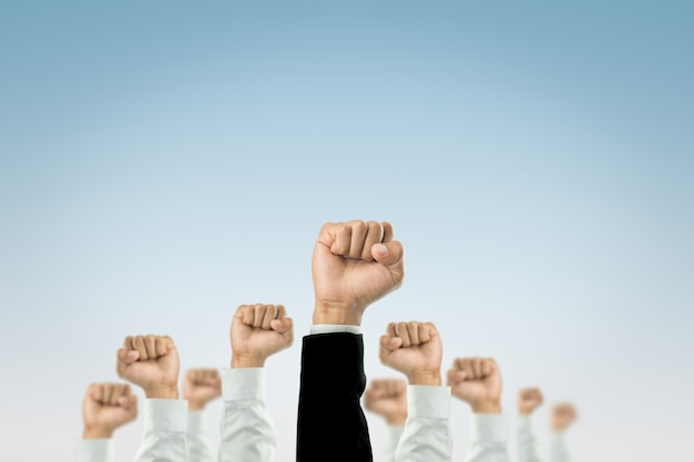 Businessmen raised their hands to win the celebration of the organization.