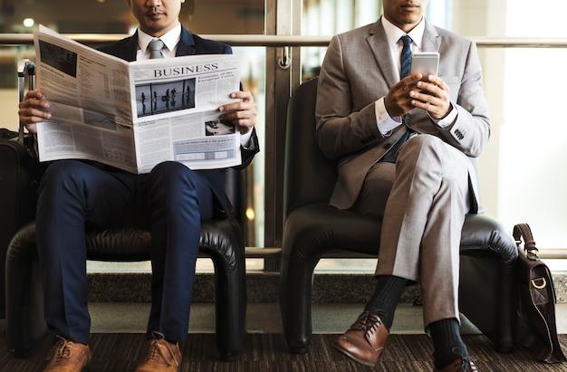 Businessmen reading the news