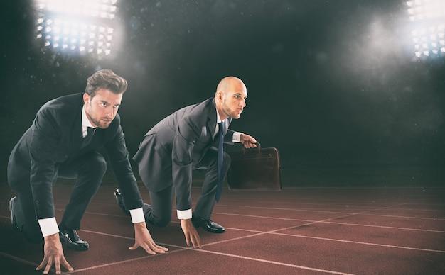 Бизнесмены готовы к старту. конкуренция и вызов в бизнес-концепции.