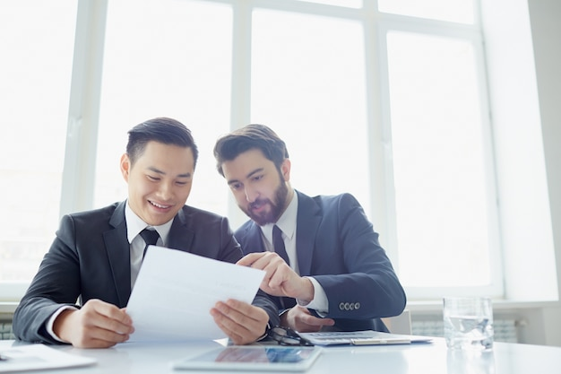 Businessmen reviewing the summary