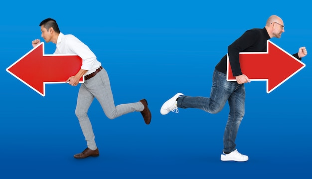 Businessmen running in different directions