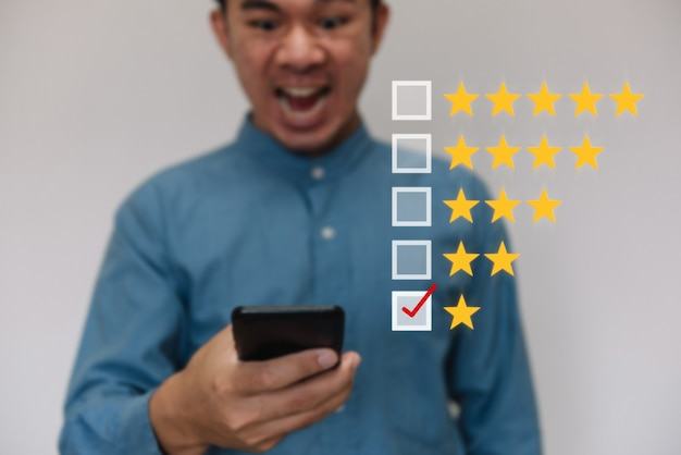 Businessmen selecting the level of satisfaction score icons with copy space.