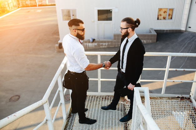 Businessmen shaking hands on stairs