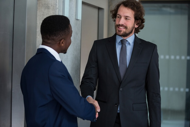 Businessmen shaking hands with each other