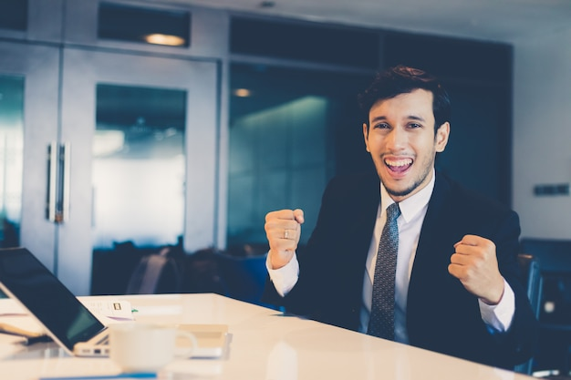 Businessmen success and winning with raised up hands celebrating the breakthrough and achi