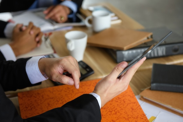 Businessmen team discuss project using tablet