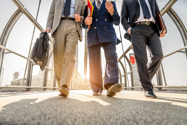 Businessmen walking outdoors