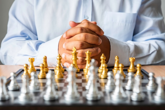 Businessmen who are planning to strategize with a chessboard placed in the foreground - business planning concepts