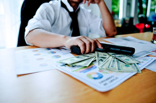 Businessmen with money in hand, us dollars, investment, success and profitable business id