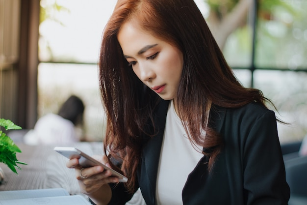 Businessmen and women are using mobile and touch smart phone for communication