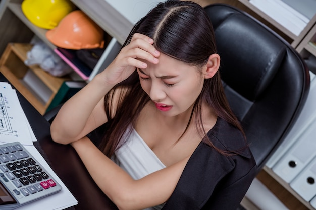 Businessmen, women working in the office with stress and fatigue.