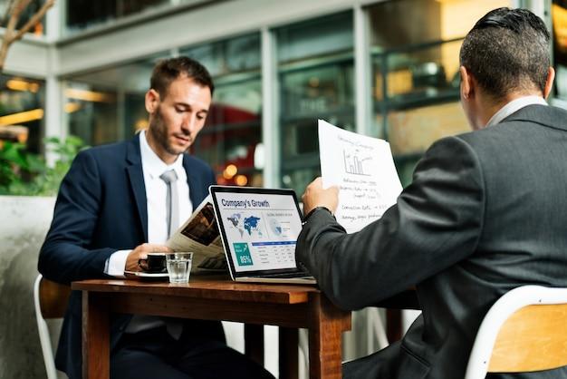 Businessmen working cafe laptop paperwork concept