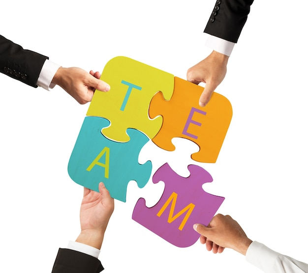 Businessmen working together to build a colored puzzle. concept of team that works together