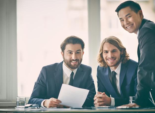 Businessmen working with window background
