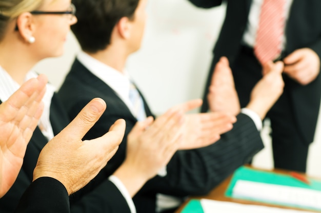 Businesspeople applauding at a meeting