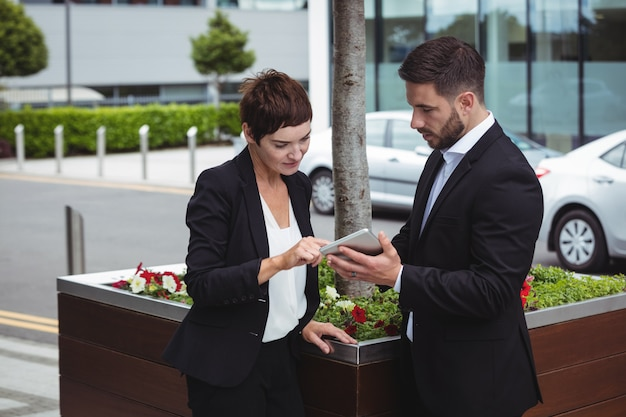Businesspeople discussion on digital tablet