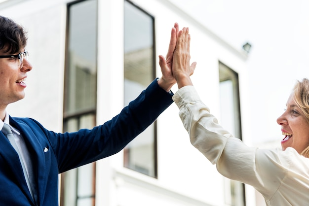 Businesspeople giving a high five together