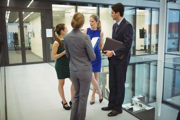 Businesspeople having a discussion in the corridor