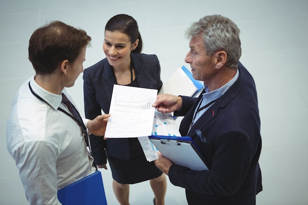 Businesspeople having discussion over document
