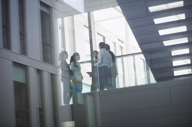 Businesspeople interacting inside office building