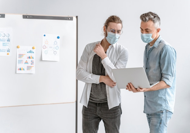 Businesspeople meeting at office wearing masks