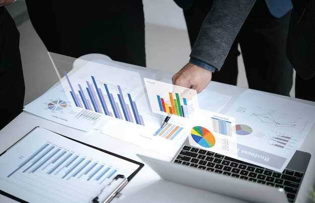 Businesspeople meeting plan analysis graph company finance strategy statistics success concept and planning for future in office room.