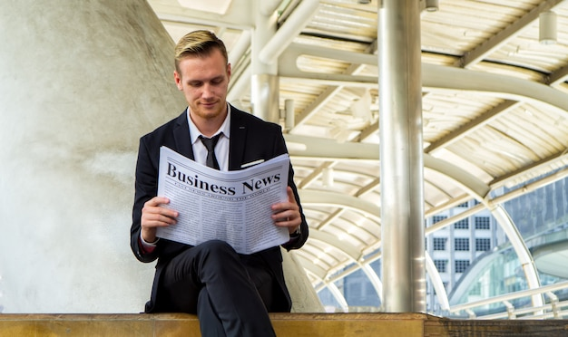 Businesspeople reading business newspaper