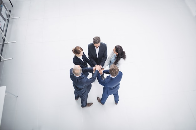 Businesspeople stacking hands together