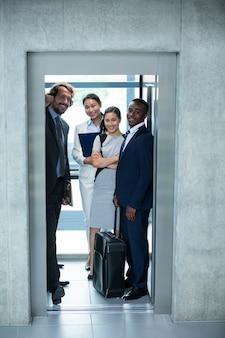 Businesspeople standing in elevator