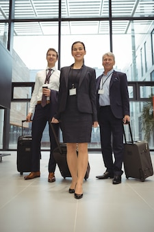 Businesspeople standing together with luggage