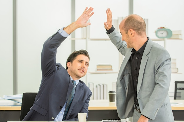 Businesspeople teamwork joining hands together for business success