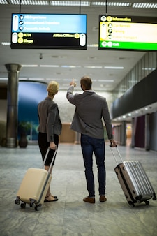 Businesspeople walking with luggage
