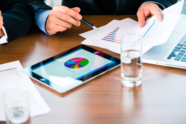 Businesspeople working with tablet computer