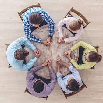 Businessteam working at empty meeting table, top view