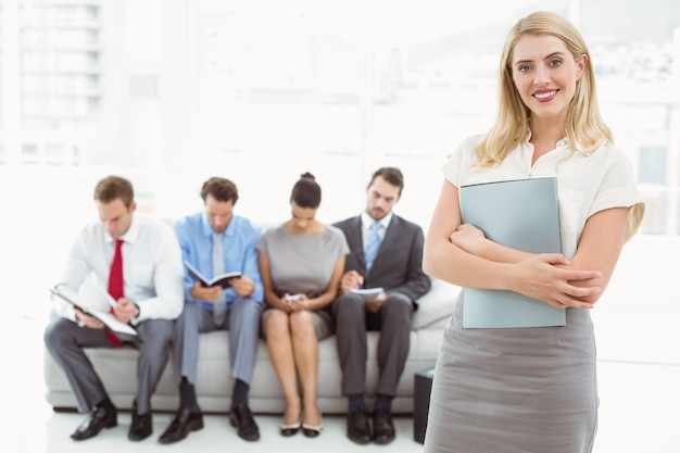 Businesswoman against people waiting for interview