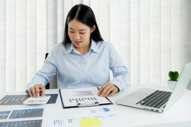 Businesswoman analysis the chart and meeting video conferencing with laptop at the home office for setting challenging business goal