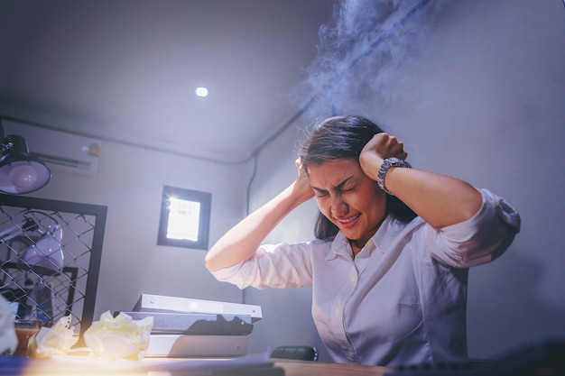 Businesswoman are stressed while overtime working. serious and tired working.