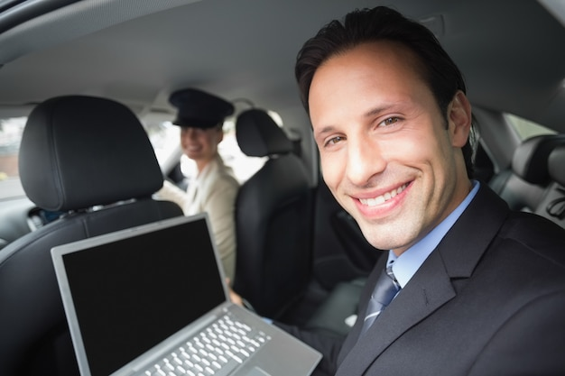 Businesswoman being chauffeured while working