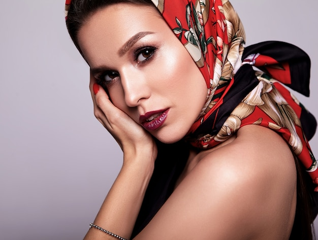 Businesswoman in black dress with evening makeup and colorful lips in red shawl