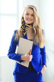 Businesswoman in blue dress