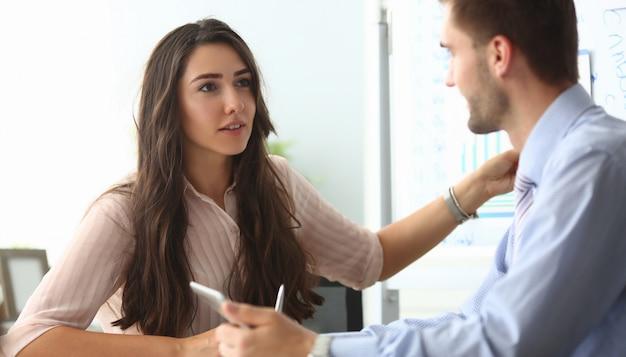 Businesswoman and businessman communicate