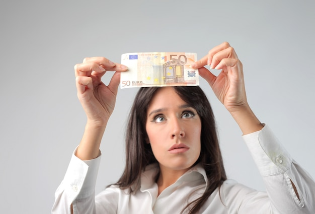 Businesswoman checking a paper money