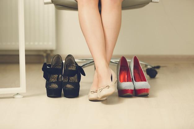 Businesswoman choosing comfortable shoes instead of high heels