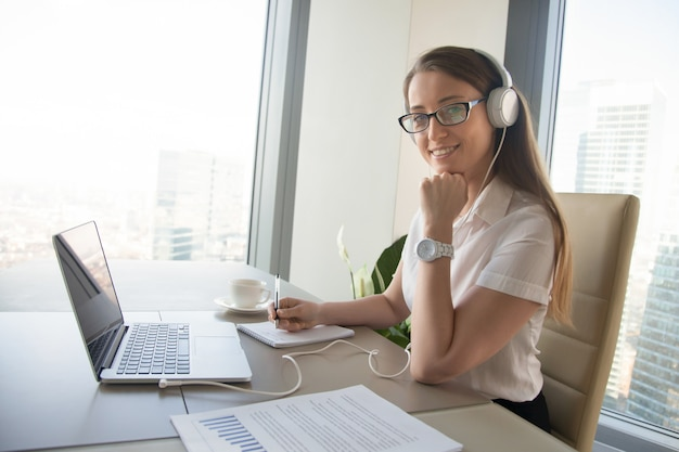 Businesswoman communicates with colleagues online