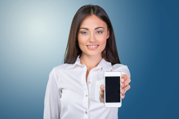 Businesswoman displaying mobile phone isolated touch screen