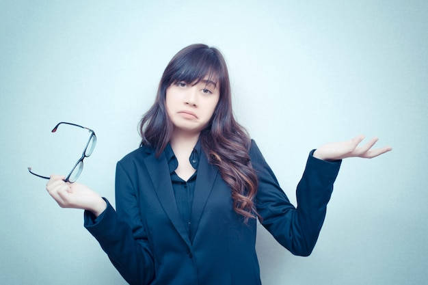 Businesswoman gestures confusion with her hands. business woman is acting in the concept of