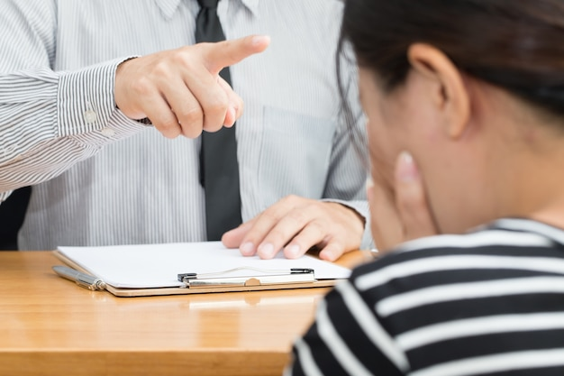 Businesswoman getting intimidated after scolded by boss