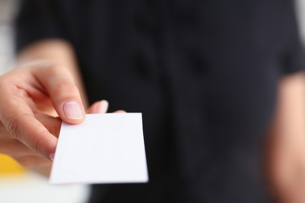 Businesswoman give her business card to her new partner closeup