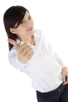 Businesswoman give you a excellent gesture by thumbs up, portrait.